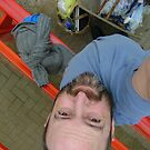 self-portrait from above, with odd baggage, awaiting train by armadillozenith