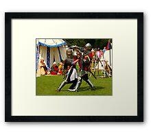 Battling knights at the village fayre Framed Print