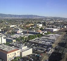 Angular aerial view of street, buildings and mountains in San Jose by ashishagarwal74