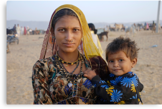 Gypsy woman with Child at Camel Fair by AravindTeki