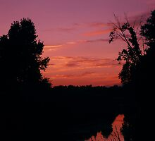 Sunset at the river  by tamckee