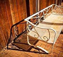 A bench and its shadow by Elana Bailey