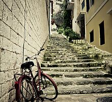 Bicycle left behind by Yannis Larios