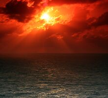 Sunset Over the Caribbean Ocean by Bernai Velarde