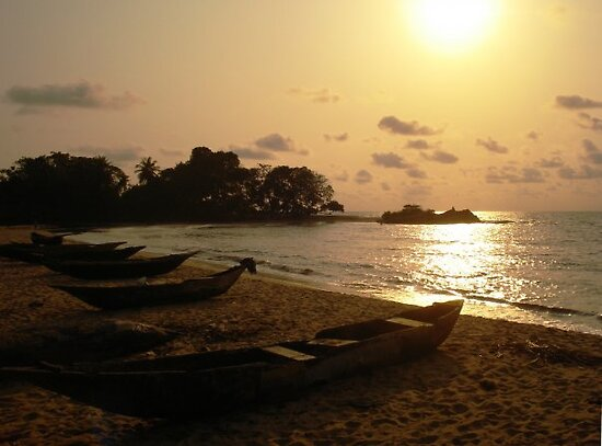 Canoes in sunset - Kribi, Cameroon by Mils