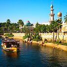 Beautiful palace with palm and ship on river by komashyaru
