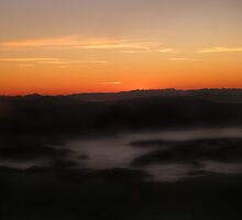 Mist Over the Italian Alps at Sunrise by Hallie Duesenberg