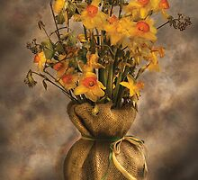 Daffodils in a Burlap Vase by Mike  Savad