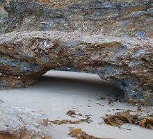 Tunnel in rock by Graham Mewburn