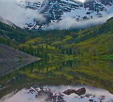 The Maroon Bells in clouds by Paul Gana