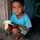 Boy and banana by Mario Soares Ferreira by Friends  of Suai
