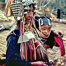 Akha  mother with baby by John Spies