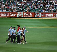 Streaker being covered up, Melbourne Cricket Ground   by HandyAndy