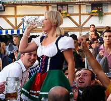 Blonde Finishing Beer at Oktoberfest by Paul Mc Namara