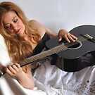 Woman and Black Guitar Portrait by Daidalos