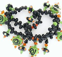 black and green glass necklace with a dash of orange by betty porteus