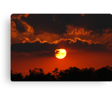 A Nearly Full Sun Sunset Canvas Print