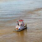 Tug Boat and The Mississippi River by Wanda Raines