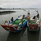Fishing boats at twilight on the Danshui River Taiwan by photoslot