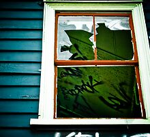 Spooky abandoned house with a broken window and graffiti by yurix