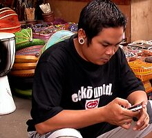 Young Man with an Earring in Ubud Market, Bali by JonathaninBali