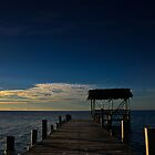 Sunset over the pier at Glovers Reef by Karel Kuran