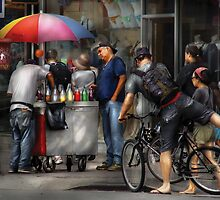 Getting a snowcone  by Mike  Savad