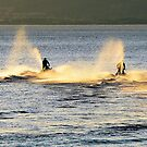 Jet skis at sunset by wizard327