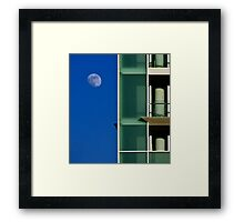 The moon and the building Framed Print