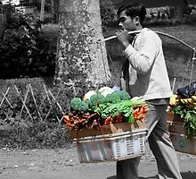 Man carrying veggies by Charuhas  Images