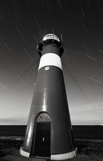 Lighthouse and startrails by Joel Tjintjelaar