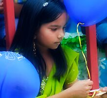 A Girl With Two Blue Balloons by Jarede Schmetterer