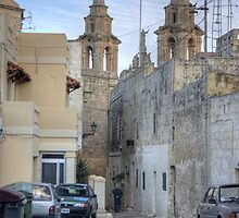 Typical Maltese village scene by M G  Pettett