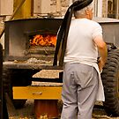 Brittany Baker Prepares His Wood Buring Oven for Baking Bread by Buckwhite