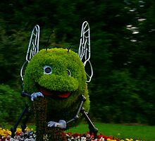 I think he is a bit big for them flowers by blueguitarman