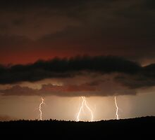 Lightning and Cane Burn glow near Whiporie by Michael Bath