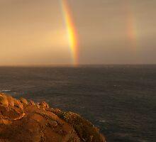 cliff rainbows by Tony Middleton