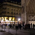 Notre Dame and Cafe, Christmas Eve by Robert Arconti