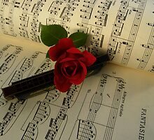 A rose for our Monica by IngridSonja