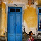 girl by the blue door by Sonia de Macedo-Stewart