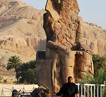 Walking by Memnon Colossus by Carlos Rodriguez