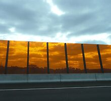 Looking through orange perspex barrier ~ Eastlink, Frankston to Ringwood Freeway by lols