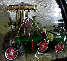 Antique car and carosel. by Marilyn Baldey
