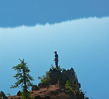 Man on Cliff by Gene  Tewksbury