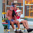 Two men and a baby ... by Danceintherain