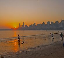 Sun set over Chowpatty Beach, Mumbai, India by dhphotography