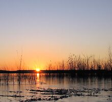 Sunrise Over An Icy Lake by WILDBRIMOWILDMAN