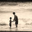 A Father's Grip by Chris Odchigue