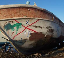 retired fishing boat and a bicycle by cassandragrj