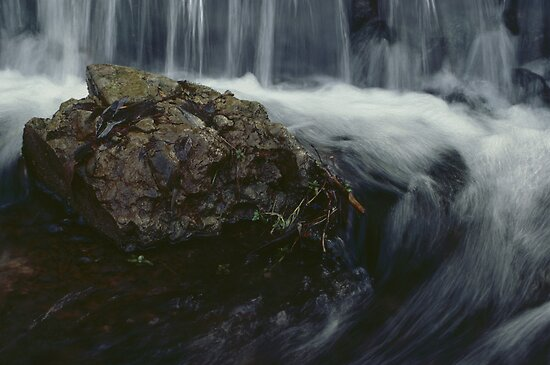 Waterfall Cascade Surrounds a Rock by DMHImages